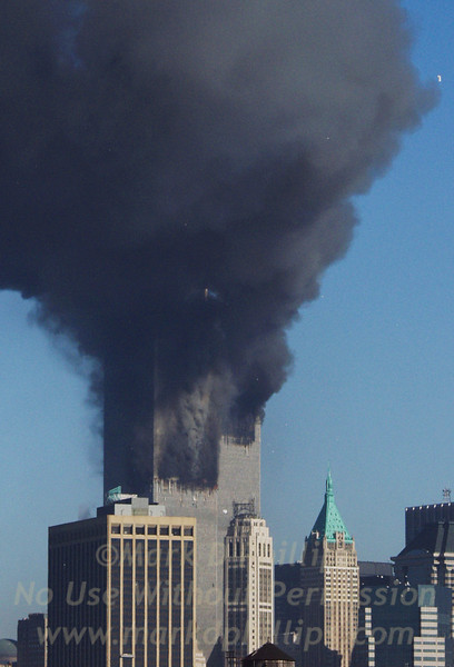 Face in the smoke of World Trade Center on September 11, 2001 just seconds after the second plane struck the south tower.  MANDATORY CREDIT: ©2001,markdphillips.com/Mark D. Phillips  NOT TO BE PRINTED OR RETRANSMITTED WITHOUT EXPRESSED WRITTEN PERMISSION OF THE COPYRIGHT HOLDER.  Contact mark (at) markdphillips.com for licensing contracts.