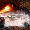 ~King Neptune's Chamber~<br /> <br /> A few days each year with a cloudless sky, the setting sun filters a golden shaft of light that illuminates this 200 foot Sea Tunnel on the Oregon Coast.  The pounding surf can be felt with each wave crashing into the cave.  After a few minutes the golden light slowly fades away.