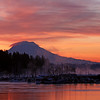 ~Gig Harbor Freeze~<br /> <br /> This is the Gig Harbor boat marina with Mount Rainier as a backdrop.  The morning I shot this, December 9th 2009,  it broke an all-time weather record, for being the coldest day ever recorded in the Greater Puget Sound area.<br /> <br />  I couldn't adjust my camera with gloves on, so when I returned to my truck my fingers felt like they were going to break off like an icicles, and shatter on the ground. <br /> <br />  I'm usually excited about capturing scenes like this, but It was miserable, until I arrived home to a hot cup of coffee.