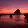 ~The Silent Sentinel~<br /> <br /> <br /> Haystack Rock bids farewell to another evening at Cape Kiwanda Oregon.  <br />  It is the fourth tallest sea stack in the world with a height of 327 feet.
