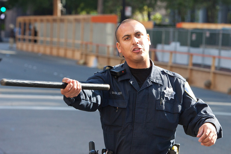 Officer Baglieri Motions to the Crowd to Move Back, Oakland Riots, 2010