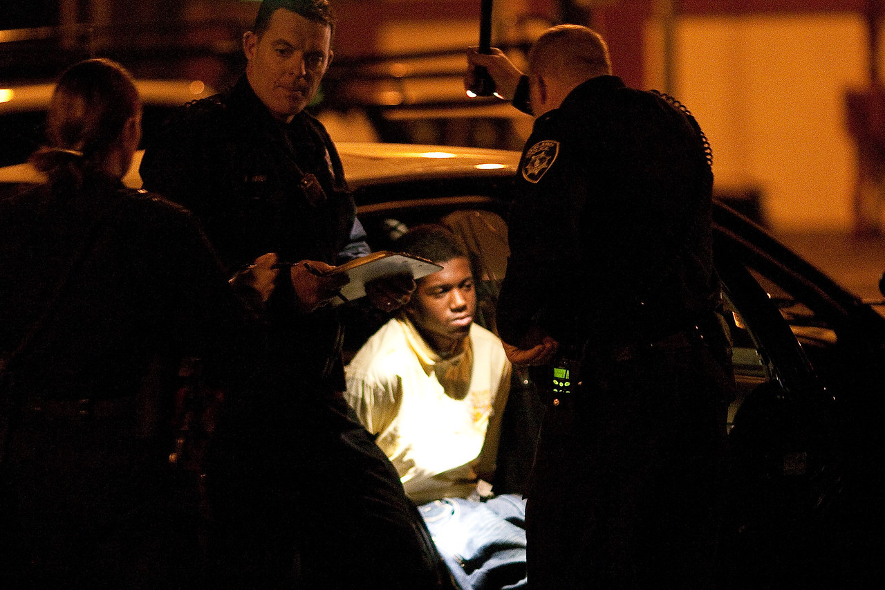Kid Handcuffed in the Back of a Police Car, Oakland Riots
