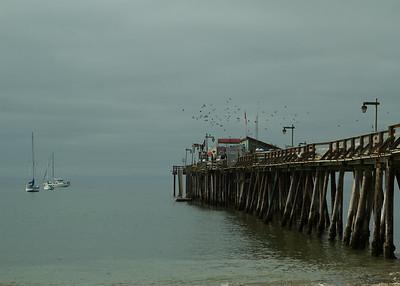 Ocean pier with sailboats