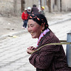 Woman with milk churn, Tibet