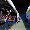 Jump Kick<br /> A Takraw match seen in a community park<br /> Bangkok, Thailand