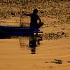 A Fisherman in Ripples<br /> Kanchanaburi, Thailand