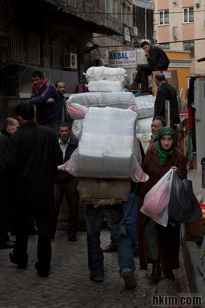 One Man Carrying, Nine Men Waiting, and One Woman Passing<br /> Istanbul, Turkey
