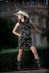 "09/25/2011 ***Strike a Pose*** Celine at the North side of the Texas state Capitol. She is definitely learning to strike a pose.  [edit by david: For this photo, as I recall, I was in front of Celine and on the camera's left.  We used a ""flash-sicle"" with an umbrella.  Athough I forgot to bring a pole and my painter pole adapter (http://blog.sundayschildsnapshots.com/wp/2011/09/diy/the-poor-mans-painter-pole-adapter), we did have a light stand with us, which is effectively the same thing. The flash was mounted atop the lightstand with an umbrella and extended.    The flash was fired using Nikon's CLS.  (Did I mention today how much I like CLS?)]"