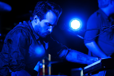 09/23/2011 ***Men in Blue*** Rising up to Indigo's blue challenge, this image is from Sunday's concert. The blue lights were so strong on stage that when I tried to correct the white balance, I couldn't, not even off the keyboard. I'm thinking about creating a collage of this picture in numerous tones. One of them I wanted to have flesh tones on flesh. But alas, I guess I will have to do it with variations of blue, purple and green. One of the things that popped out at me when I processed this image is the way the lens flare is resting over his heart. Hmmmm...I just realized that I posted this too early for Indigo's challenge. Oh well, I'l have to post yet another blue image in a few days :)