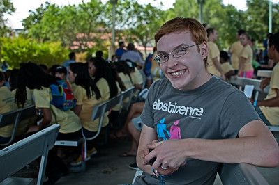 Thursday August 23, 2012  I was looking for something to process and post for a daily and I ran into this little gem... I hadn't noticed when I took the shot that most of the people in the background are girls. Suddenly, the sinister look takes on a whole new meaning. I believe he plans to woo them with his t-shirt.