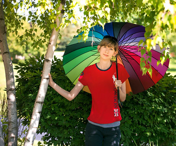"Kathleen and I have aquired a few new umbrella props for portraits. This one is a color wheel that we picked up on the ""fashionable east side"". I kinda like it!"