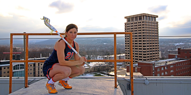 Photo shoot of Syracuse University's Kayla Treanor on top of the Carrier Dome for the cover of the March issue for Inside Lacrosse Magazine.  Treanor has been dubbed the best player the women's program in Syracuse has ever seen per head coach Gary Gait.  January 26, 2016.  Carrier Dome, Syracuse, NY.