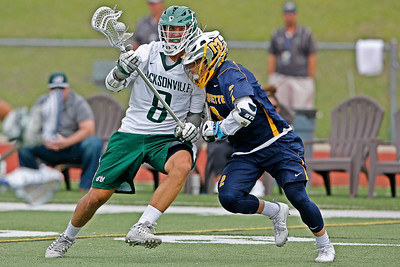 Marquette's Noah Joseph with an aggressive press against Jacksonville's Eric Applegate during a defensively brilliant performance by Marquette.  February 18, 2017.  D.B. Milne Field at JU, Jacksonville, Florida.