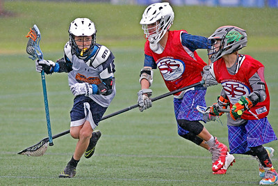 Heavy rains wouldn't stop the 2022/2023 Florida Extreme and South Tampa Sticks from competing in a Florida Travel Lacrosse League game.  January 29, 2017.  Pine Trails Park, Parkland, Florida.
