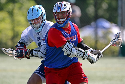 Philippines attacker Mario Ventiquattro throws a behind the back pass against Israel's Justin Lurie during a 7-3 victory at the Heritage Cup which is an annual international showcase event.  May 26, 2019, Shipley School, Bryn Mawr, PA