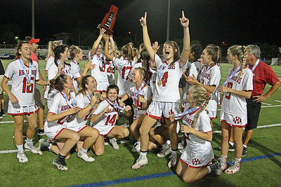 Lake Highland Preps girls celebrate with the Florida State Championship trophy moments after capping a 23-2 season with an 11-6 win over the Benjamin School to win their first state championship in legendary coach Chris Robinson's first season at the helm.  May 10, 2019, Boca Raton High School, Boca Raton, FL