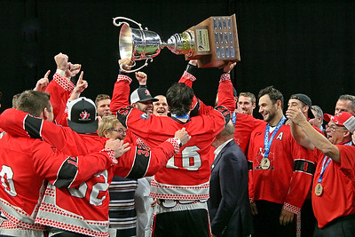 Team Canada's Chris Corbeil hoists the Cockerton Cup after beating the Iroquois Nationals 19-12 to win the Gold Medal at the World Indoor Lacrosse Championship.  September 28, 2019, Langley Events Centre, Langley, BC.