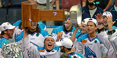 Game MVP Cody Jamieson hoists the Champions Cup after his Rochester Knighthawks came back to beat the Edmonton Rush 9-6 in the National Lacrosse League Championship Game. May 19, 2012.