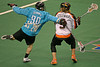 The Philadelphia Wings are the first professional team in the United States to replace last names with twitter handles on the back of their jerseys. Mike Hominuk is photographed chasing down the Buffalo Bandits Mark Steenhuis. The jerseys were auctioned off after the game with the proceeds going to the American Cancer Society.  February 12, 2012.