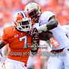 "Clemson Tigers linebacker Tony Steward (7) rushes the QB as a Boston College Eagles lineman blocks him in the first half of a game between the Boston College Eagles and the Clemson Tigers at Memorial Stadium ""Death Valley"" in Clemson, South Carolina."