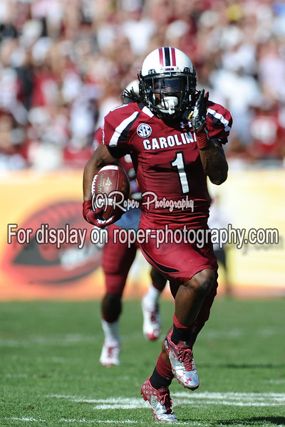 South Carolina Gamecocks wide receiver ACE SANDERS (1) returns a punt for a touch down in the first half of the 2012 NCAA Outback Bowl between the South Carolina Gamecocks and the Michigan Wolverines at Raymond James Stadium.