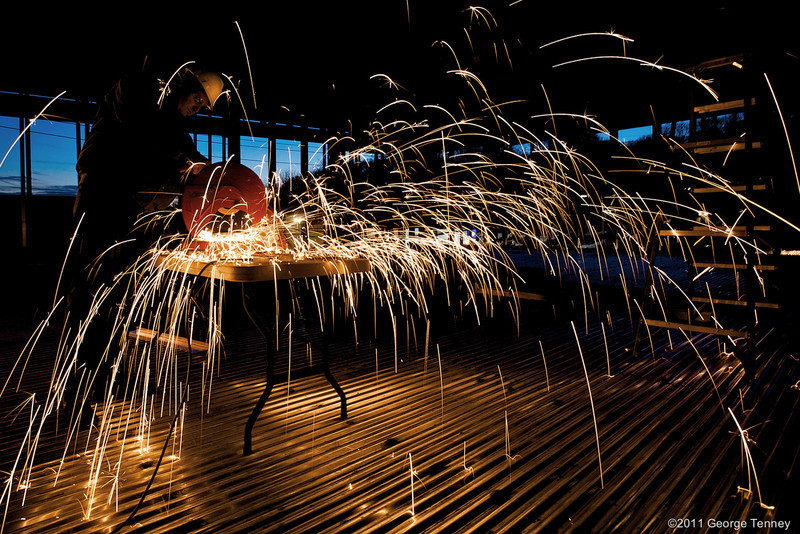 Construction worker cutting metal