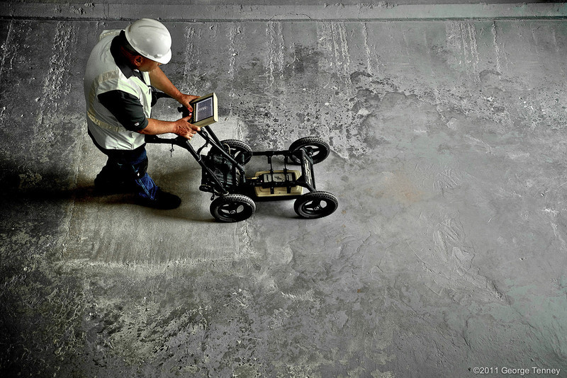 Technician using ground penetrating radar floor scanner