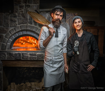 Portrait-of-chefs-in-brick-oven-kitchen