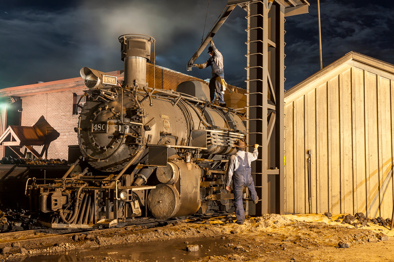1925 2-8-2 Mikado type Baldwin Steam Locomotive with train crew at work at Durango and Silverton Narrow Gauge Railroad Night Photo Shoot.