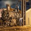 1925 2-8-2 Mikado type Baldwin Steam Locomotive with train crew at work at Durango and Silverton Narrow Gauge Railroad Night Photo Shoot.