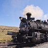 Cumbres and Toltec Narrow Gauge train, with coal-fired steam engine, going from Antonito, Colorado, to Chama, New Mexico. The train's route takes it over the more than 10,000 foot Cumbres Pass, and the route follows both the Los Pinos River and the Colorado and New Mexico state line, crossing back and forth between states multiple times.