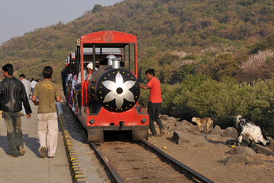 A little chaotic, one just hops onto the train as soon as it arrives. The train trakes you from the foot-hills of the caves to the jetty - a short distance. The Elephanta Caves are located just off Mumbai harbour in the Gharapuri Island also called Elephanta Island - a name given by the Portuguese when they ruled over this area. In 1987, the caves were designated a UNESCO World Heritage Site. Hewn out of solid rock, the Elephanta Caves date back to 600 AD. The caves attract many visitors who take an hour long ferry boat ride to reach from Gateway of India. The cave complex is a collection of rock-cut architecture with stone sculptures of Hindu Gods and Goddesses.
