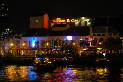 Boats float in Singapore river as seen at Clarke Quay, Singapore. June' 2004.