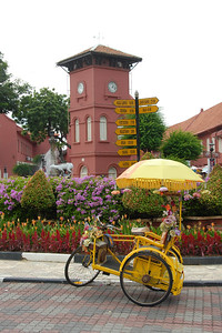 Colourful tricycle in Melaka, Malaysia used to carry tourists around the city.
