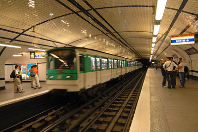 Train entering the station in the subway of Paris, France