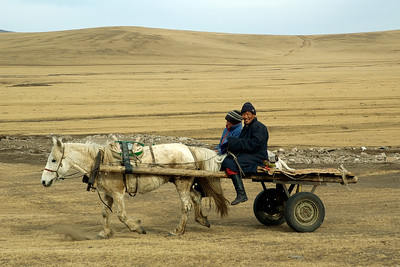 Mongolian couple on their way home... [Mongolia] This image has been taken in rural Mongolia. Traditional transportation is still very common. :)