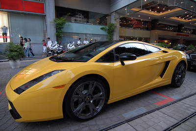 Swanky car parked outside a Hotel on Orchard Road, Singapore.
