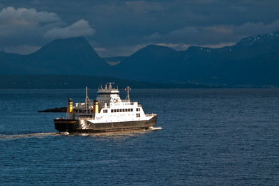 Car ferry Tresfjord The car ferry Tresfjord on it's way across the Moldefjord, operating the busy Molde - Vestnes service