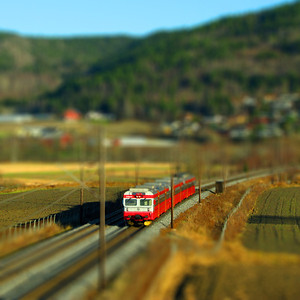 Model train? Model railroad? No, it's just heavy editing, with simulated tiltshift effect, which makes it look like a miniature train. The train is an NSB BM69 local train, outside Drammen.