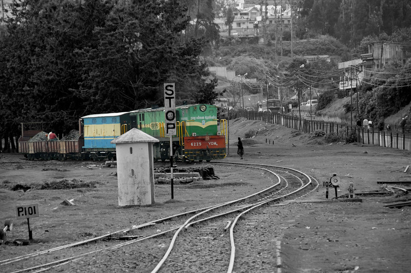 View at the Ooty railway station. For the Niligiri Passenger Train (NMR) this station is the starting point for the train to go to Mettupalayam (near Coimbatore). It was sheer joy to travel on the meter gauge steam locomotives which is one of the oldest mountain railways in India (since 1899). In July 2005, UNESCO added the NMR as an extension to the World Heritage Site of Darjeeling Himalayan Railway.<br /> Ooty, Tamil Nadu, India. July 2007