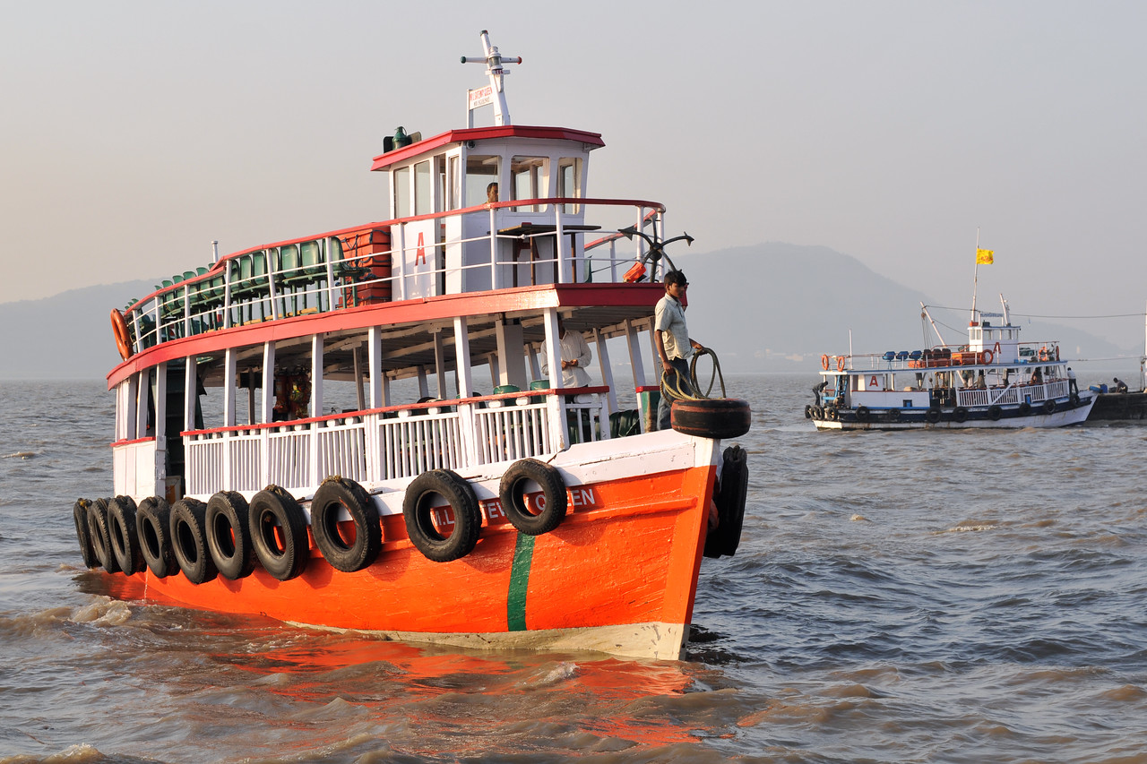 Ferry ready to take passengers from Elephanta for Mumbai. The Elephanta Caves are located just off Mumbai harbour in the Gharapuri Island also called Elephanta Island - a name given by the Portuguese when they ruled over this area. In 1987, the caves were designated a UNESCO World Heritage Site. Hewn out of solid rock, the Elephanta Caves date back to 600 AD. The caves attract many visitors who take an hour long ferry boat ride to reach from Gateway of India. The cave complex is a collection of rock-cut architecture with stone sculptures of Hindu Gods and Goddesses.