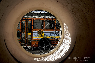 A trolley passes by the circular window at the historic City Hall on Meeting Street in Charleston.
