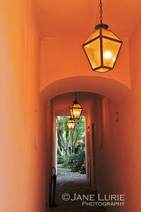 A soft lit alleyway of a house in the historic district of Charleston.