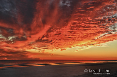 A setting sun creating dazzling effects on the lowcountry sky in South Carolina.
