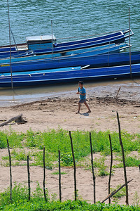 Little Boy and Blue Boats Mekong River, Laos