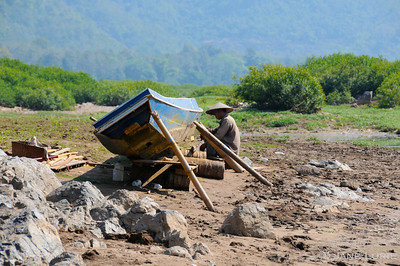 Boat Repair Along the Mekong.