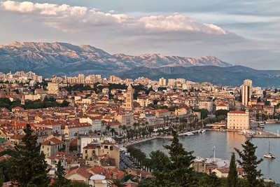 Split at sunset.  The tower in the center marks Diocletian's Palace with the rest of the old town spilling out towards the west.  The Riva, a wide boardwalk, runs along the waterfront and is filled with cafes,