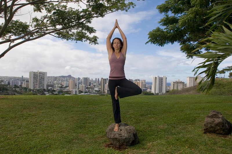 Mary Bastien, owner of Open Space Yoga in Chinatown on the island of Oahu poses near Punchbowl crater Oct 19, 2007. Bastien was one of several 'ambassadors' picked to represent Lululemon Atletica clothing line in Hawaii.