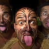 (left to right) Maka Clawson of Hawaii, Tehina Fitzgerald (center) of Turengi, New Zealand and Iraia Bailey of Hamilton, New Zealand display traditional Maori warrior facial expersions during the Polynesian Cultural Center's 40th anniversary celebration week in Laie, Hawaii on Oahu's North Shore Wednesday, October 22, 2003.  Maori warriors use tamoko (facial tatoos) and whatero (protruding tongues) to provoke or intimate enemys. The Polynesian Cultural Center provides cultural exposure to the people and heritages of seven island nations, Fiji Hawaii, New Zealand, Samoa, Tahiti, Tonga and the Marquesas. REUTERS/Lucy Pemoni