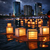 "Hundreds of lanterns float in the waters off of Magic Island in Ala Moana Park in Honolulu, Hawaii, May 31, 2004 during the annual Toro-Nagashi (Lantern Floating) Ceremony. The lanterns with names of family and friends who have gone from this world are set afloat in the shores of the Pacific Ocean to serve as beacons to their dead souls so they can find their way back to the spirtual world. The Lantern Floating Ceremony, organized by the Shinnyo-en temple of Hawai'i, precedes the Obon Festival or ""Feast of the Dead"". The ceremony is also held on Memorial Day weekend to pray for the souls of the war dead and highlight the need for world peace. REUTERS/Lucy Pemoni"
